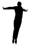 Une silhouette branchante de vol d'homme d'affaires Images stock