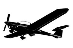 Une silhouette d'un petit avion préparant pour atterrir Photo libre de droits