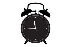 Une silhouette d'une rétro horloge d'alarme Images stock