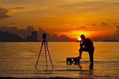 Une silhouette de photographe Photos libres de droits