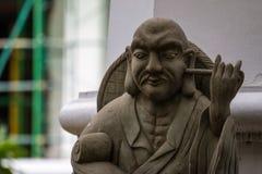 Une statue chinoise dans le temple bouddhiste images stock