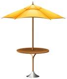 Une table avec un parapluie Images libres de droits
