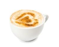 Une tasse de cappuccino avec la mousse, cannelle Images stock