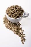 Une tasse de haricot vert de café de Colombie Photo libre de droits