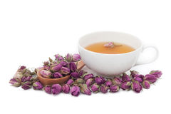 Une tasse de thé rose sur le fond blanc Photos stock