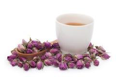 Une tasse de thé rose sur le fond blanc Photographie stock
