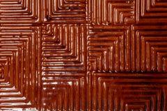 Une texture remarquable de tuile de double de rouge sur une base en céramique photos libres de droits