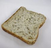 Une tranche de pain entier Photos stock
