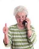 Une vieille dame avec le téléphone portable Images stock