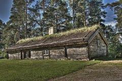 Une vieille maison en bois suédoise des 1690s dans HDR Images libres de droits