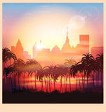 Une ville au lever de soleil illustration libre de droits