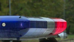 Une voiture de police clignote banque de vidéos