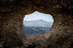 Une vue par un trou dans le mur Photo libre de droits