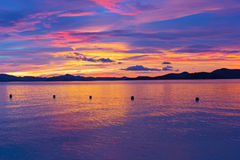Unearthly sunset colors on a tropical island. Royalty Free Stock Photos