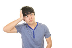 Uneasy Asian man Royalty Free Stock Photography