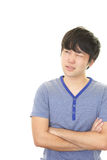 Uneasy Asian man Royalty Free Stock Image