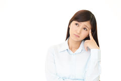 Free Uneasy Asian Woman Stock Image - 87765071
