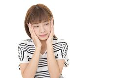 Uneasy Asian woman. Portrait of woman looking uneasy stock images