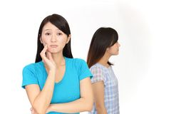 Uneasy Asian women. Asian women with sad expression royalty free stock photo