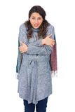 Uneasy pretty model with winter clothes being cold Stock Images