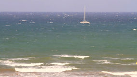 Uneasy sea and catamaran. Mediterranean Sea, fall, September stock video footage