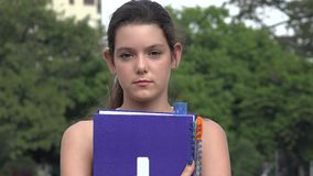 Unemotional female teen student. A young pretty Colombian teen girl stock footage