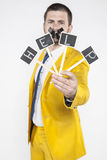 Unemployed businessman calling for help. Wearing a gold suit Royalty Free Stock Photo
