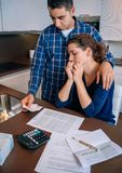 Unemployed husband gives solace to his wife crying Stock Photos