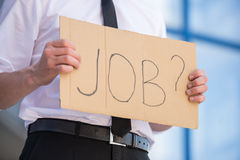 Unemployed man. Close-up of man in suit holding sign in hands. Unemployed man looking for job Royalty Free Stock Photo