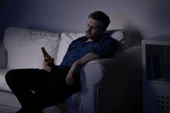 Unemployed man drinking beer Royalty Free Stock Photo