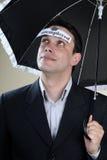 Unemployed man staying under umbrella Stock Photos