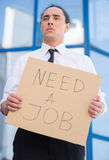 Unemployed man. Man in suit holding sign in hands. Unemployed man looking for job Stock Images