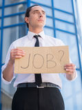 Unemployed man. Man in suit holding sign in hands. Unemployed man looking for job Royalty Free Stock Photo