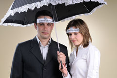 Unemployed people staying under umbrella Stock Photography