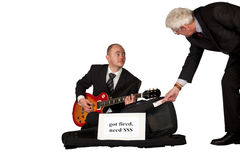 Unemployed playing guitar for money Royalty Free Stock Photo