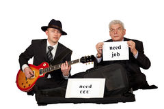 Unemployed playing guitar for money and job Stock Images