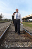 Unemployed Senior Businessman Walks Railroad Tracks Stock Photos