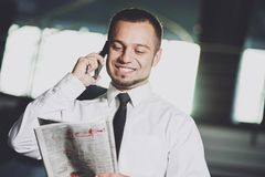 A young man is looking for a job. The guy looks at the job ads. Job wanted. Stock Photography