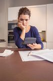 Unemployed woman with debts review monthly bills Royalty Free Stock Image