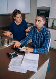 Unemployed young couple with debts reviewing their Stock Images