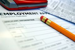Unemployment. Employment application, newspaper, and cell phone Royalty Free Stock Photography