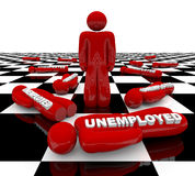 Unemployment - Last Man Standing. A red figure stands alone on a chess board, surrounded by unemployed friends Royalty Free Stock Images