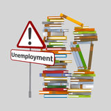 Unemployment signal in front of a mountain of books. Stock Image