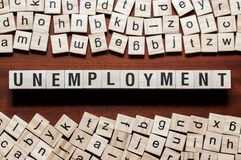 Unemployment word concept on cubes stock images