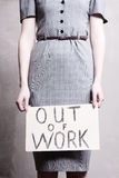 Unemployment. Young girl holds a cardboard sign. Out of Work Royalty Free Stock Photos
