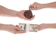 Unequal exchange. Money for a bad commodity. Royalty Free Stock Photos