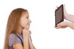 Unerwartetes Geschenk - die Tablette Stockfotos