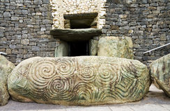 UNESCO Heritage - Triple Spiral at Newgrange. Newgrange, UNESCO World Heritage site, megalithic passage tomb in Ireland. View over the entrance stone with the royalty free stock photos