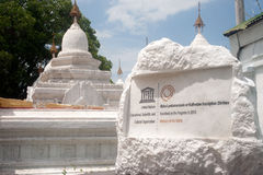 The Unesco label of white pagodas in Kuthodaw temple. Royalty Free Stock Images