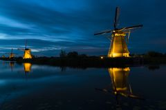 Mills by night at Kinderdijk, The Netherlands royalty free stock photo